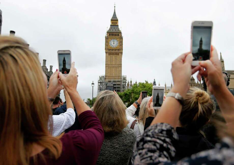 Spectators gathered at noon on Aug. 21 as Big Ben sounded for the last time before major conservation work begins.(AP Photo/Frank Augstein) Photo: Frank Augstein, STF / Copyright 2017 The Associated Press. All rights reserved.