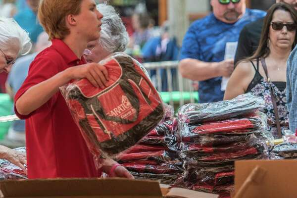 It was give-away day at the Saratoga Race Course Monday Aug. 21, 2017 in Saratoga Springs, N.Y.  as fans line up for their Saratoga cooler bags.  (Skip Dickstein/Times Union)