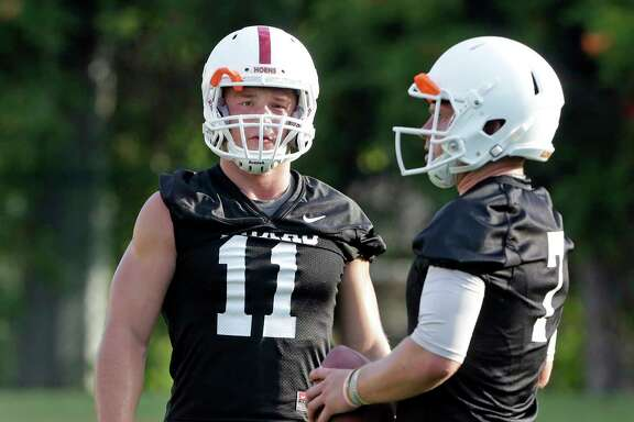 Sam Ehlinger (11) is pushing Shane Buechele for Texas' starting quarterback job even though Buechele has the edge in experience.