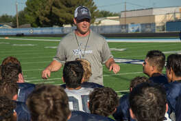Greenwood head coach Jared Sanderson talks with his players 8/14/17 morning following practice. Tim Fischer/Reporter-Telegram