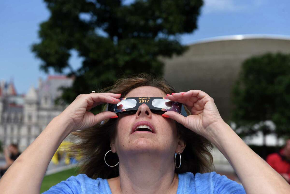 Cindy Gorzynski of Delmar view the solar eclipse from the Empire State Plaza on Monday, Aug. 21, 2017, in Albany, N.Y. (Will Waldron/Times Union)