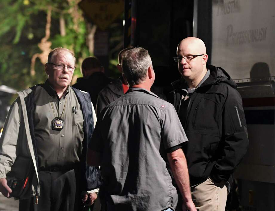 Rensselaer County District Attorney Joel Abelove, right, speaks with law enforcement members at the scene on 8th Street and Rensselaer where a man was shot by police in the North Central neighborhood on Tuesday about 6:40 p.m., on Aug. 15, 2017, in Troy, N.Y.  The man was wounded and taken to Albany Medical Center Hospital. (Will Waldron/Times Union) Photo: Will Waldron