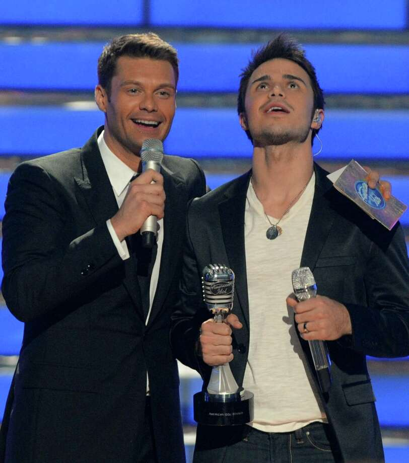 ABC's new rendition of 'American Idol,' which, like its Fox predecessor, will feature Ryan Seacrest as host, has scrapped planned S.A. and Houston audition stops due to the devastation by Hurricane Harvey and subsequent floods. Here, Seacrest congratulates 2009 winner Kris Allen, right, as he clutches the 'American Idol' trophy.Click ahead to view how much rainfall Central Texas cities got from Hurricane Harvey. Photo: Associated Press / AP