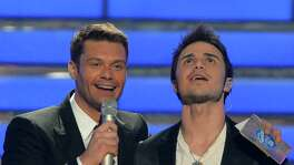 Ryan Seacrest, seen here with one of 'Idol's' winners Kris Allen, will return as host of the new 'American Idol' on ABC.