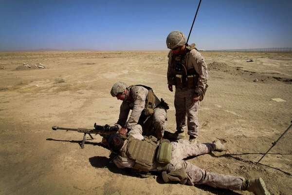 Marines attempt to sight in a .50 caliber rifle in Helmand Province, Afghanistan. The 16-year conflict has resulted in the deaths of 2,403 Americans.