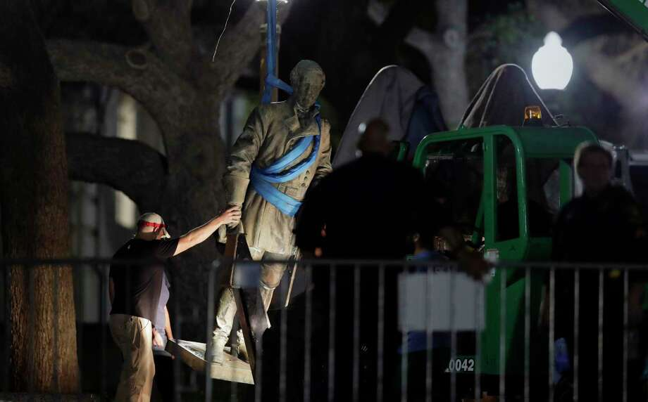 A statue of Confederate general Robert E. Lee was removed from the University of Texas campus early Monday morning. Photo: Eric Gay, STF / Copyright 2017 The Associated Press. All rights reserved.