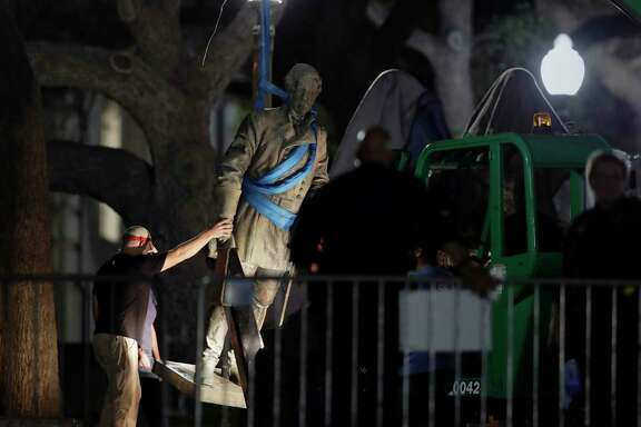 A statue of Confederate general Robert E. Lee was removed from the University of Texas campus early Monday morning.