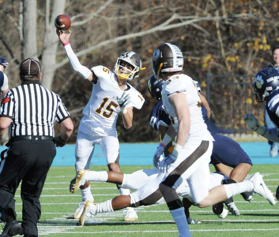 Brunswick quarterback Nicky Henkel (15), center, passes to Brunswick receiver Kieran Dowley (33), at right, during the Wayne Sanborn Bowl championship high school football game between Brunswick School and Cheshire Academy at Cheshire Academy, Conn., Saturday, Nov. 19, 2016. Cheshire Academy beat Brunswick 45-20 to win the championship. Photo: Bob Luckey Jr. / Hearst Connecticut Media / Greenwich Time