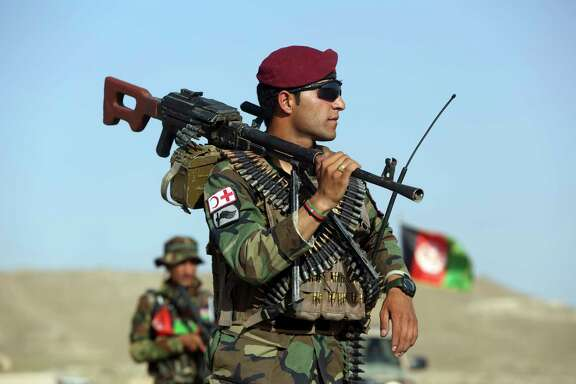 Afghan National Army soldiers stand guard at a checkpoint in Kabul, Afghanistan, on Monday.