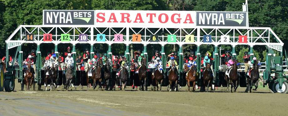 Arrogate with jockey Mike Smith leaves the #1 stall of the starting gate and goes on to win the 147th running of the Travers Stakes at the Saratoga Race Course August 26, 2016 in Saratoga Springs, N.Y.    (Skip Dickstein/Times Union) Photo: SKIP DICKSTEIN / 20037808A