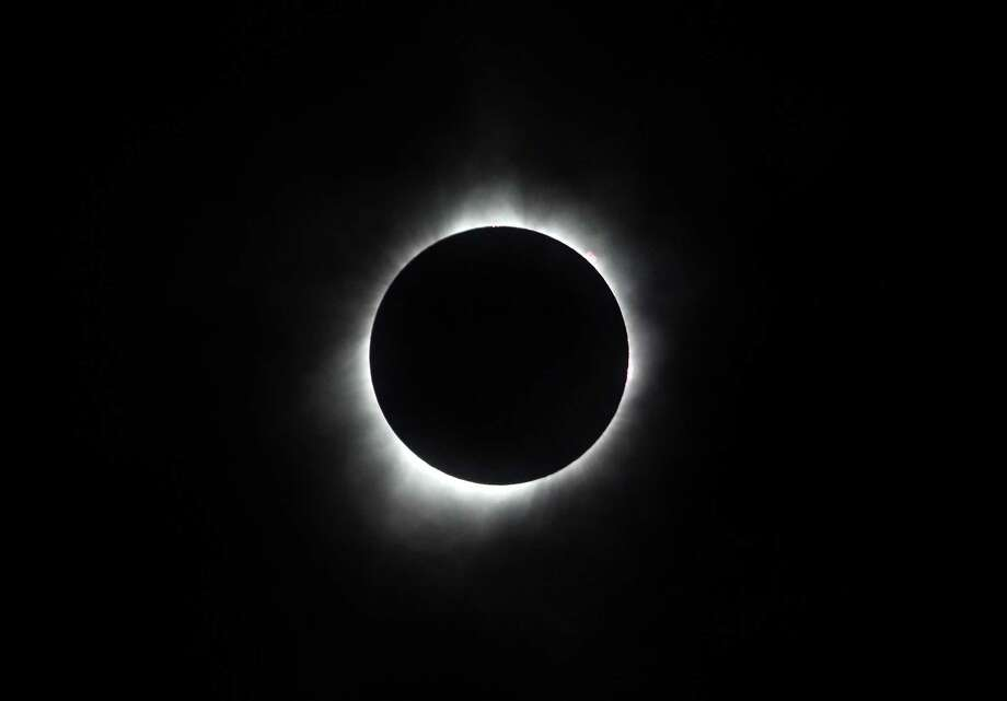 """HIAWATHA, KS - AUGUST 21:  The sun is seen in full eclipse over a park on August 21, 2017 in Hiawatha, Kansas. Millions of people have flocked to areas of the U.S. that are in the """"path of totality"""" in order to experience a total solar eclipse. (Photo by Jamie Squire/Getty Images) ORG XMIT: 700022505 Photo: Jamie Squire / 2017 Getty Images"""