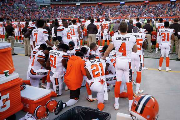 CLEVELAND, OH - AUGUST 21: A group of Cleveland Browns players kneel in a circle in protest during the national anthem prior to a preseason game against the New York Giants at FirstEnergy Stadium on August 21, 2017 in Cleveland, Ohio.