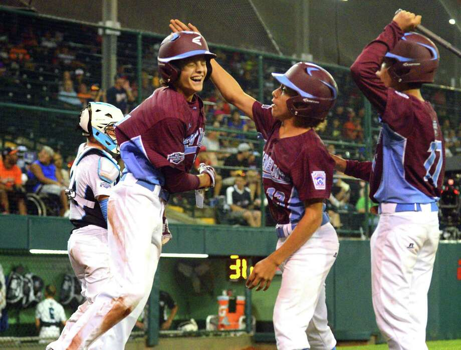 Fairfield American's Ethan Righter, right, celebrates a homerun by teammate Michael Iannazzo during Little League World Series action against Walla Walla, WA at Lamade Stadium in South Williamsport, Penn., on Monday Aug. 21, 2017. Photo: Christian Abraham / Hearst Connecticut Media / Connecticut Post