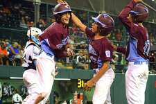 Fairfield American's Ethan Righter, right, celebrates a homerun by teammate Michael Iannazzo during Little League World Series action against Walla Walla, WA at Lamade Stadium in South Williamsport, Penn., on Monday Aug. 21, 2017.