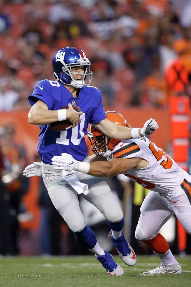CLEVELAND, OH - AUGUST 21: Eli Manning #10 of the New York Giants gets sacked by Joe Schobert #53 of the Cleveland Browns in the first half of a preseason game at FirstEnergy Stadium on August 21, 2017 in Cleveland, Ohio. (Photo by Joe Robbins/Getty Images) ORG XMIT: 700069911 Photo: Joe Robbins / 2017 Getty Images