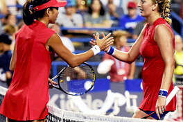 Shuai Zhang of China shakes hands with Petra Kvitova of the Czech Republic after defeating Kvitova 6-2, 6-1 during the first round of the Connecticut Open tennis tournament on Stadium Court at the Connecticut Tennis Center in New Haven.