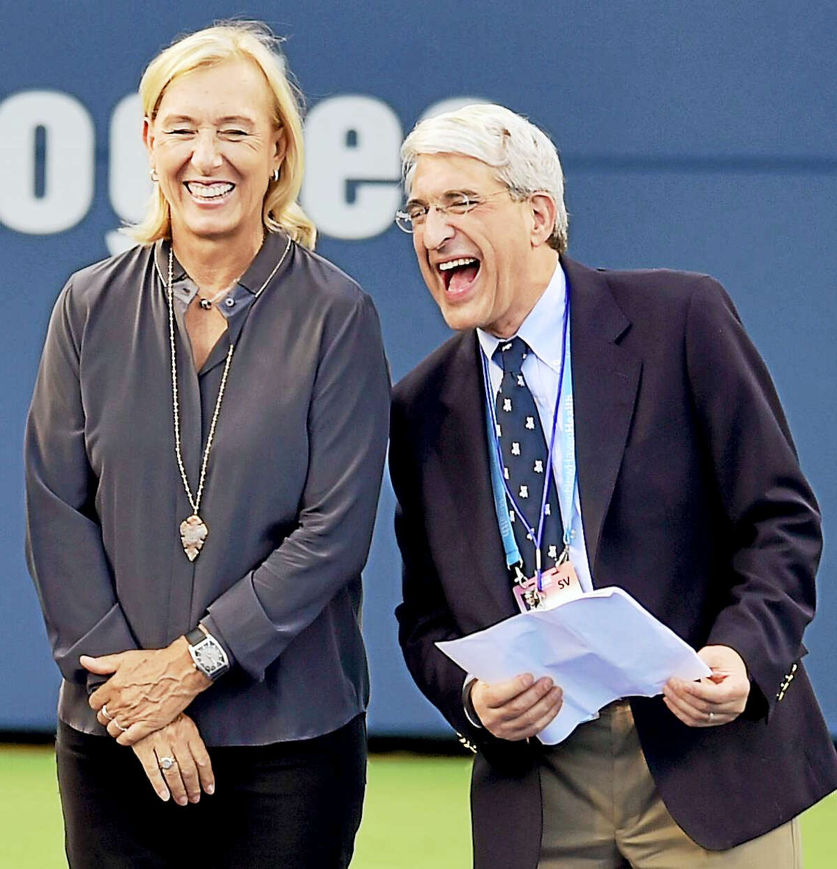 (Peter Hvizdak / Hearst Connecticut Media) New Haven,Connecticut: Monday, August 21, 2017. Legendary tennis player Martini Navratilova and Yale University President Peter Salovey share a light moment at the start of the Connecticut Open 20th Anniversary Celebration Opening Ceremony Monday evening at the Connecticut Tennis Center.