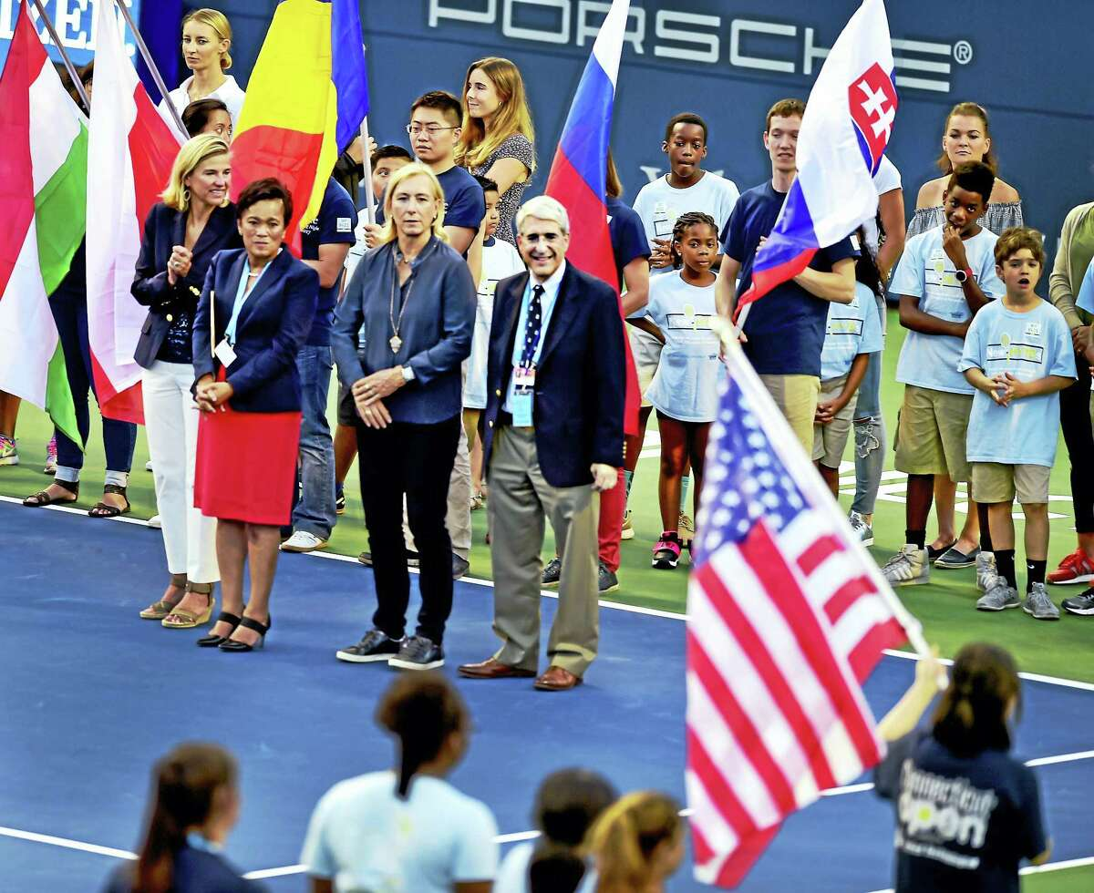(Peter Hvizdak / Hearst Connecticut Media) New Haven,Connecticut: Monday, August 21, 2017. As children of New Haven Youth, Tennis and Education program lead competing tennis players into Stadium Court, Connecticut Open tournament director Anne Worcester, New Haven Mayor Toni Harp, legendary tennis player Martini Navratilova, and Yale University President Peter Salovey during the Connecticut Open 20th Anniversary Celebration Opening Ceremony Monday evening at the Connecticut Tennis Center .