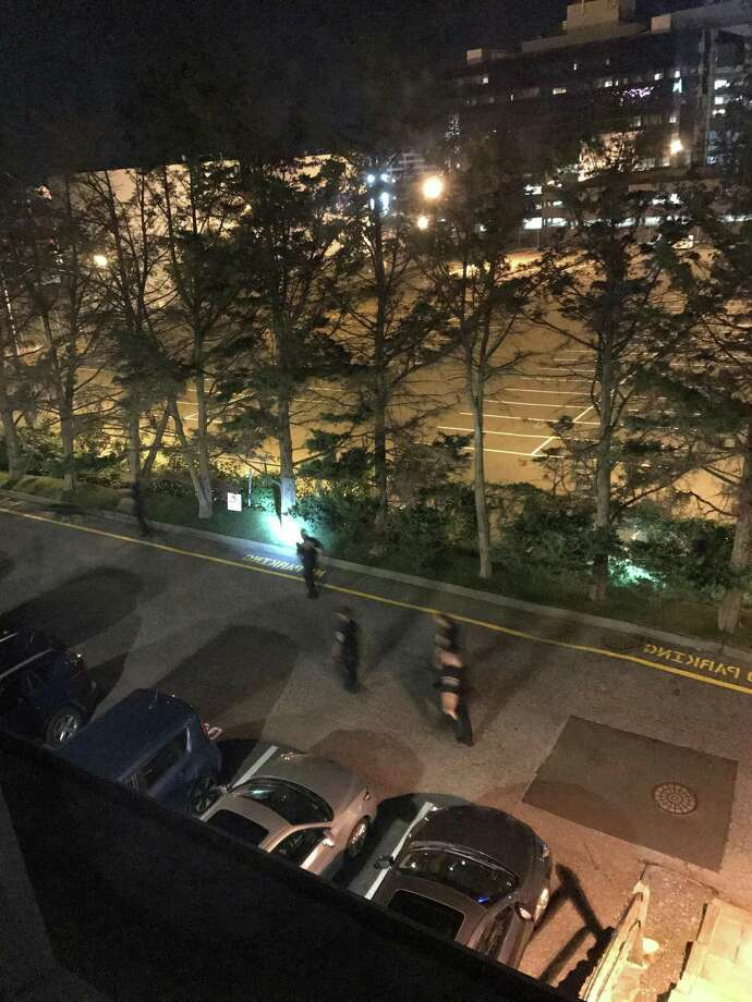 Stamford police searching on foot near Washington Boulevard following a car chase that ended in the city late Monday night. The chase, which originated in Norwalk triggered a major police response. Photo: Contributed Photo