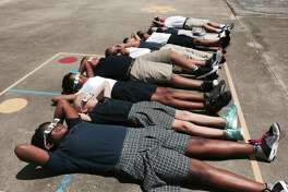 Fifth graders at St. Anthony's Cathedral Basilica School watch Monday's solar eclipse.