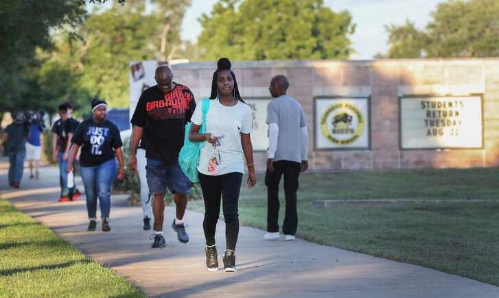 Students from the mold-infested Willow Ridge High School started their first day of school at rival Thurgood Marshalll High School Tuesday, Aug. 22, 2017, in Missouri City. Roughly 1,300 students started their academic year at their Marshall as clean up of Willow Ridge is still ongoing. ( Steve Gonzales / Houston Chronicle )