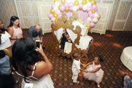 Westhill High School student Kendall Smith had her wheelchair turned into a chariot for her sweet 16 party at Water's Edge at Giovanni's in Darien, Conn. on Sunday, August 20, 2017.
