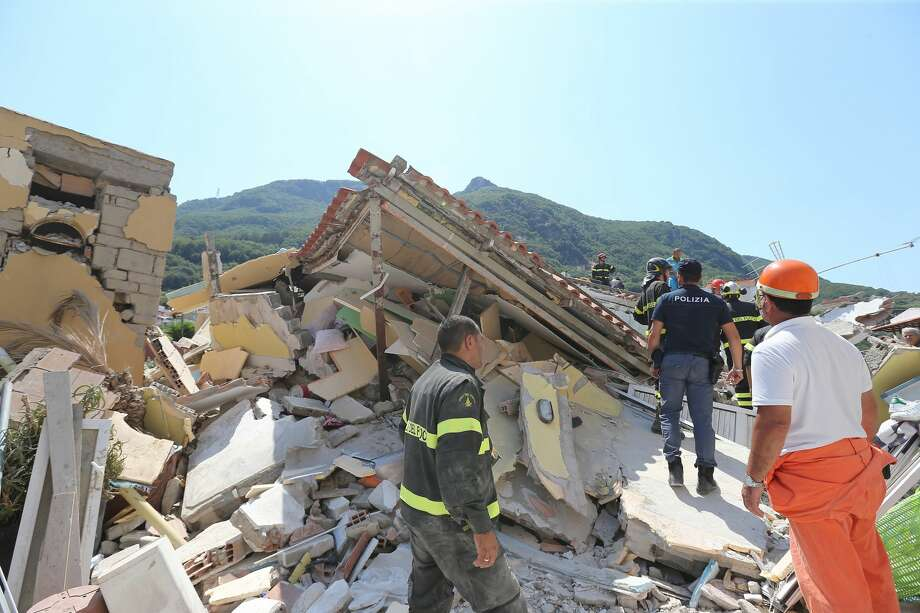 Rescuers team walk near a house, destroyed in the earthquake in one of the more heavily damaged areas on August 22, 2017 in Casamicciola Terme, Italy. A magnitude-4.0 earthquake struck the Italian holiday island of Ischia early this morning during peak tourist season, killing two women. The earthquake occurred just two days ahead of the first anniversary of an earthquake in central Italy in which 299 people died. (Photo by Marco Cantile/NurPhoto via Getty Images) Photo: NurPhoto/NurPhoto Via Getty Images