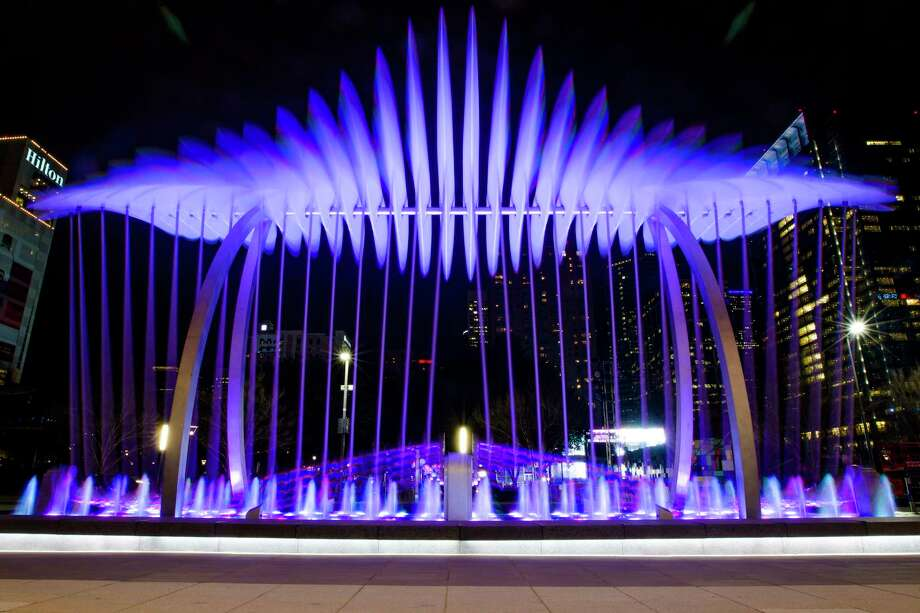"""""""Wings Over Water"""" in front of the George R. Brown Convention Center is said to be the largest kinetic outdoor sculpture in the world. It was commissioned by Houston First and Houston Arts Alliance. Photo: Michael Ciaglo, Staff / © 2016  Houston Chronicle"""