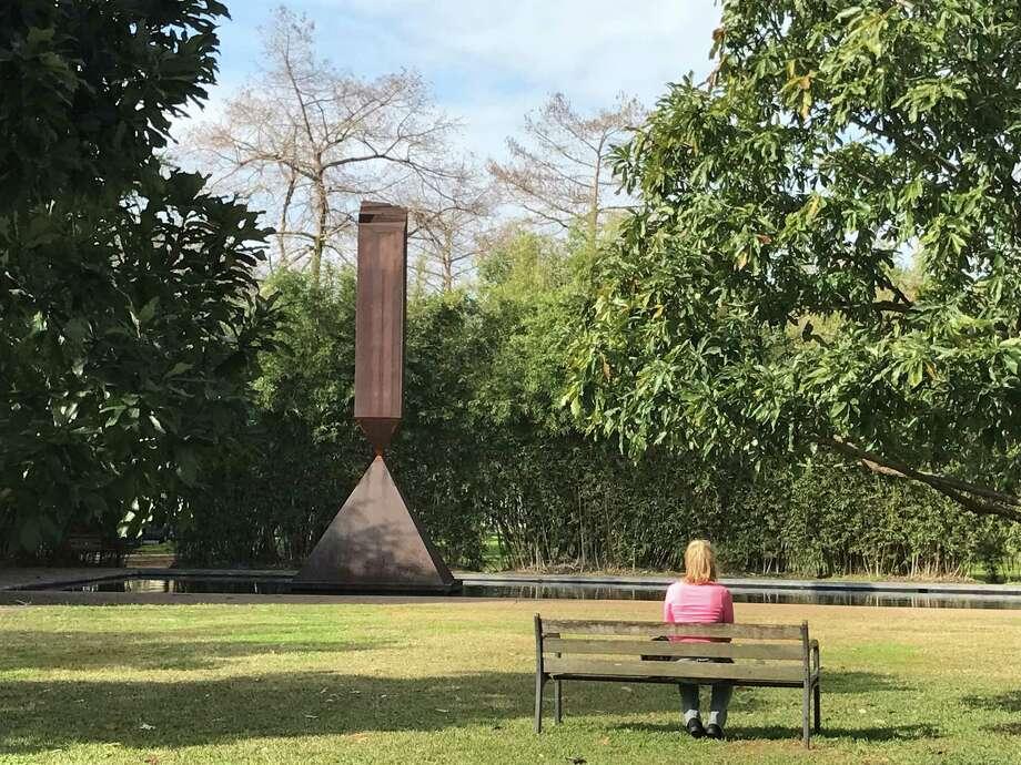 """Barnett Newman's """"Broken Obelisk"""" in the reflection pool outside the Rothko Chapel. Photo: Molly Glentzer"""