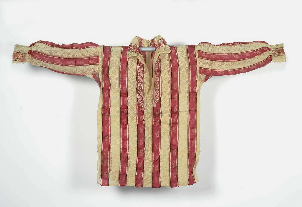 A man's shirt (barong tagalog), woven about 1800-1900 of�pi�a�(pineapple fiber), silk and cotton, with shell.