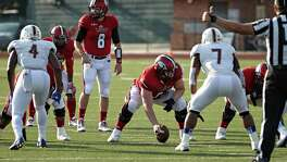"Incarnate Word quarterback Taylor Laird (8), looking over the defense at Benson Stadium in 2016, says the Cardinals being picked to finish last in the Southland Conference is ""definitely a slap to the face."""