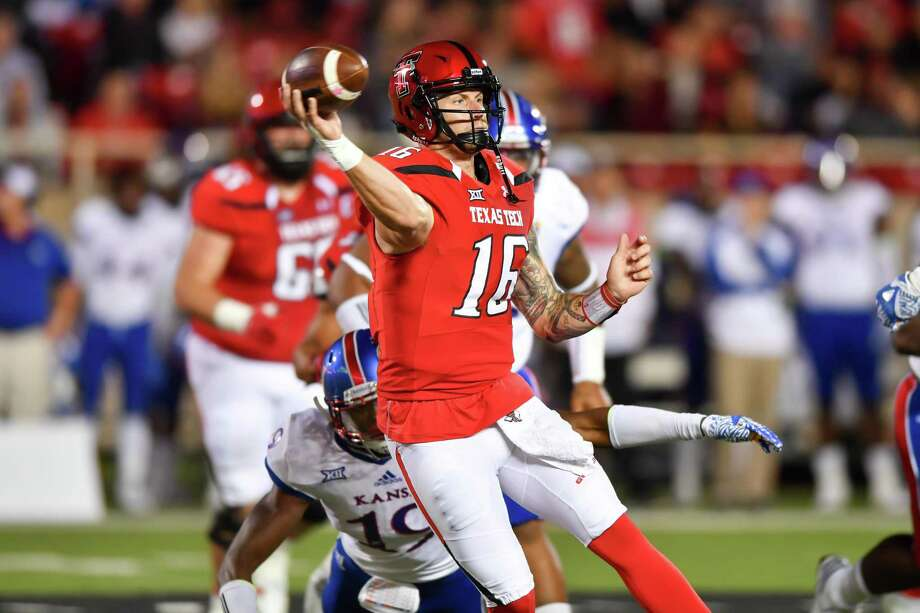 LUBBOCK, TX - SEPTEMBER 29: Nic Shimonek #16 of the Texas Tech Red Raiders passes the ball under pressure during the game against the Kansas Jayhawks on September 29, 2016 at AT&T Jones Stadium in Lubbock, Texas. Texas Tech won the game 55-19. (Photo by John Weast/Getty Images) Photo: John Weast, Stringer / Getty Images / 2016 Getty Images