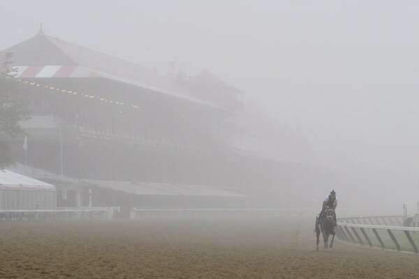 Fog hangs over Saratoga Race Course, making for an eerily beautiful morning on Tuesday, Aug. 22, 2017. (Skip Dickstein‏/Times Union)