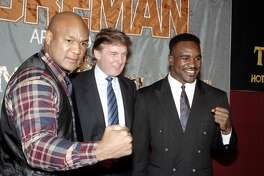 ATLANTIC CITY, NJ - CIRCA 1991: George Foreman, Donald Trump and Evander Holyfield pose during a press conference to promote their upcoming fight on April 19,1991 in Atlantic City, New Jersey. (Photo by: The Ring Magazine/Getty Images)