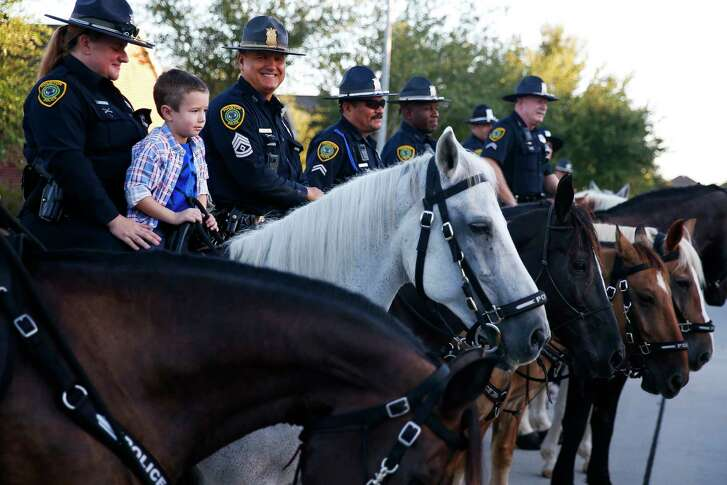 Kevin Will Jr., 5, the son of slain Houston police officer Kevin Will, sits on top of a horse as he is escorted to his first day of school by Houston police and other officers Tuesday, Aug. 22, 2017 in Cypress. Kevin Will was killed in May 2011, just months before Kevin Will Jr. was born, when a drunken driver hit Will as he investigated a traffic crash.