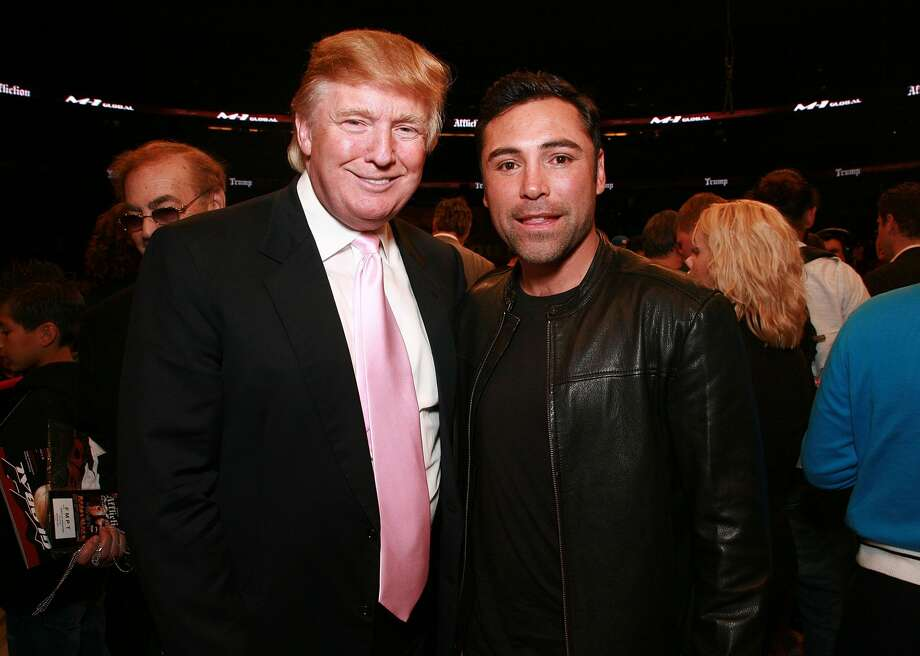 Donald Trump and World Champion Boxer Oscar De La Hoya pose at the Affliction Banned Fight: Day Of Reckoning at the Honda Center on January 24, 2009 in Anaheim, California. Photo: Tiffany Rose/WireImage