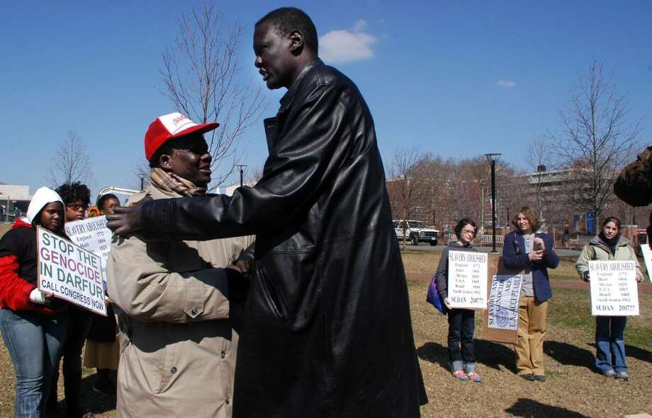 PHILADELPHIA - MARCH 23:  Former Sundanese slave Simon Deng (L) greets former NBA player, Manute Bol, after speaking with participants in a rally for action to end the violence in Sudan at Independence Hall March 23, 2006 in Philadelphia, Pennsylvania. The rally took place in support of former Sudanese slave Simon Deng's 300 mile Sudanese Freedom Walk. Deng is walking from New York to Washington, DC to shed light on modern day genocide and slavery in Sudan.  (Photo by William Thomas Cain/Getty Images) Photo: William Thomas Cain, Getty Images / 2006 Getty Images