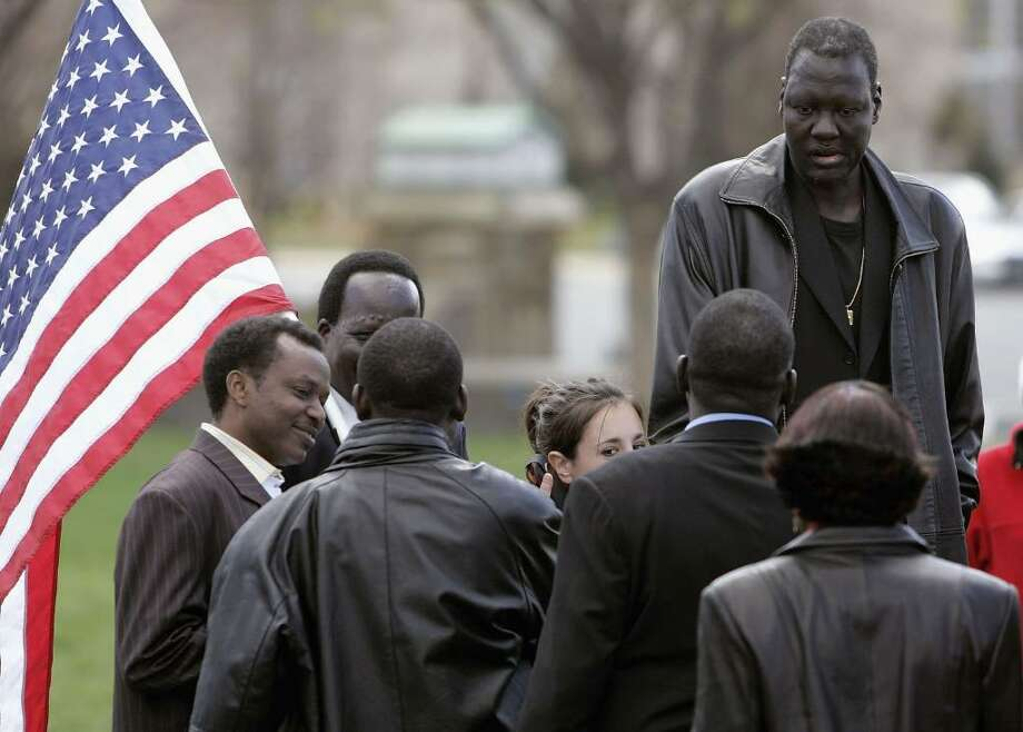 WASHINGTON - APRIL 05: 7-foot 6 inch tall Manute Bol greets people during a rallyat the U.S. Capitol April 5, 2006 in Washington DC. The rally was held to shed light on the genocide and modern-day slavery in Sudan.  (Photo by Mark Wilson/Getty Images) Photo: Mark Wilson, Getty Images / 2006 Getty Images