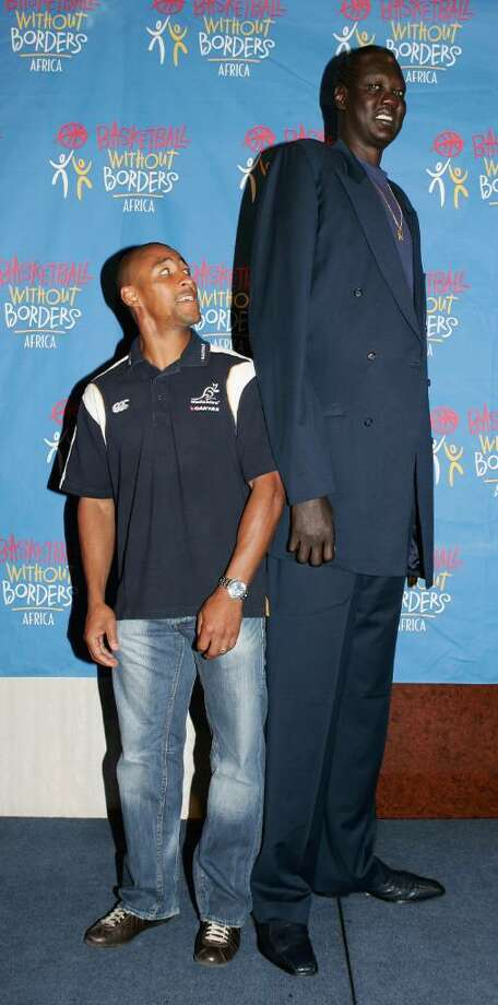 JOHANNESBURG, SOUTH AFRICA - SEPTEMBER 06:  George Gregan, the Wallaby captain meets Manute Bol, the former NBA basketball player and tallest player to play NBA. Bol is on a tour of South Africa to promote basketball in the region, pictured at the Sandton Sun Hotel on September 6, 2006 in Johannesburg, South Africa.  (Photo by David Rogers/Getty Images) Photo: David Rogers, Getty Images / 2006 Getty Images