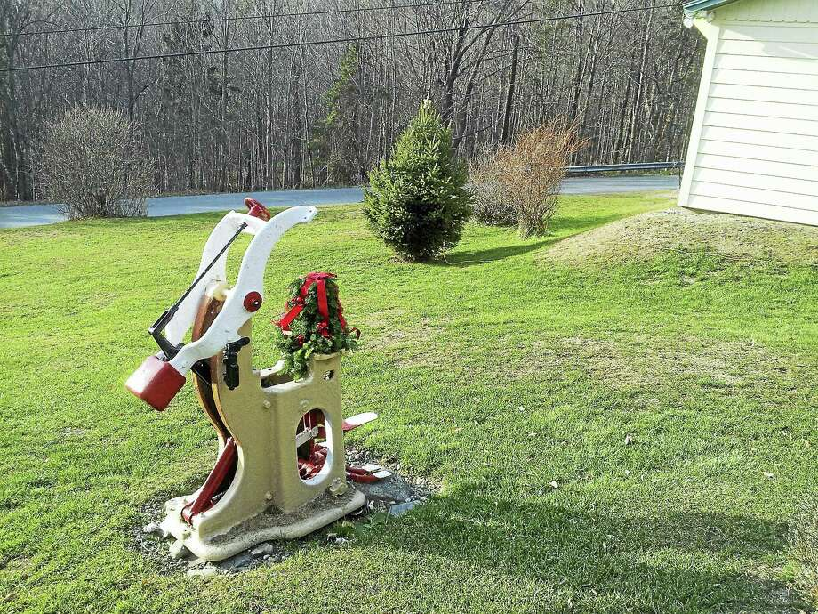 Rudolph the Red-Nosed Reindeer sculpture with the painted red nose, which Paul Keane created from the Hoffman tailor's press. Contributed photo