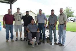 Larry Hinkle, third from the left, is walking across Texas to honor war veterans and first responders. He visited with Tomball veterans and first responders at a lunch on Monday with Steve Peltier, left, Chad Foran, Steve Vaughan, in the foreground, Jacob Peltier, Kyle Hope and Jeremy Peltier.
