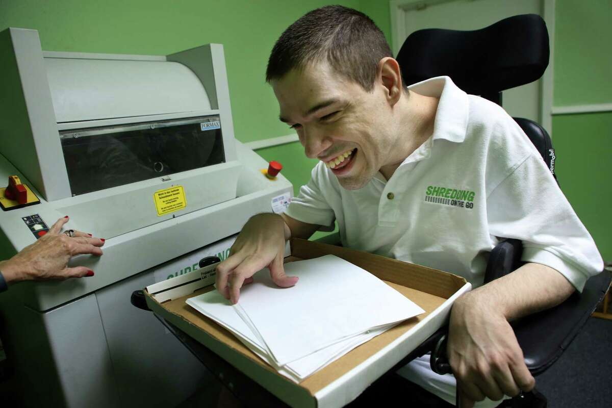 Tim Parker works to shred a box of documents at Shredding on the Go in their workspace at Neurodevelopment Therapy Services, Wednesday, Nov. 16, 2016, in Houston. ( Mark Mulligan / Houston Chronicle )
