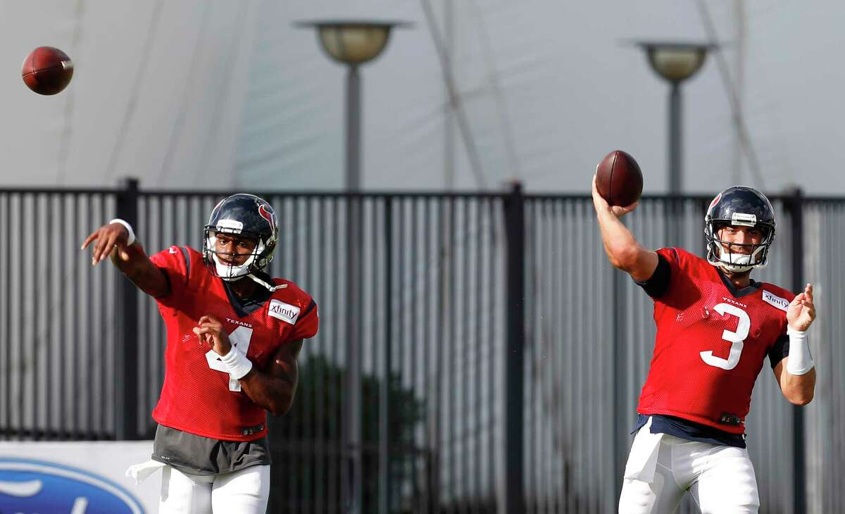 Houston Texans quarterbacks Deshaun Watson (4) and Tom Savage (3) throw passes during training camp at The Methodist Training Center on Tuesday, Aug. 22, 2017, in Houston.