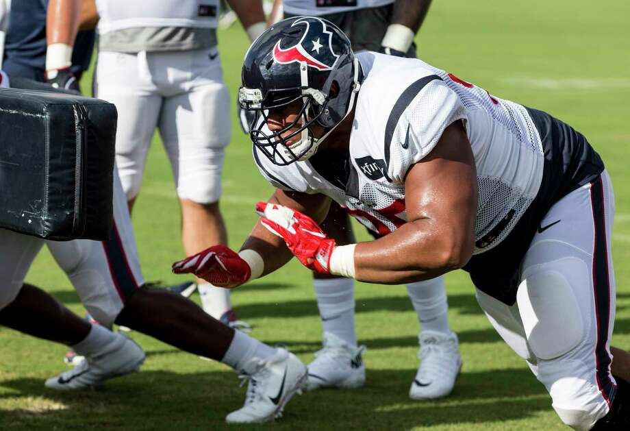 Houston Texans defensive end Christian Covington comes out of his stance to hit a blocking sled during training camp at The Methodist Training Center on Tuesday, Aug. 22, 2017, in Houston. Photo: Brett Coomer, Houston Chronicle / © 2017 Houston Chronicle}