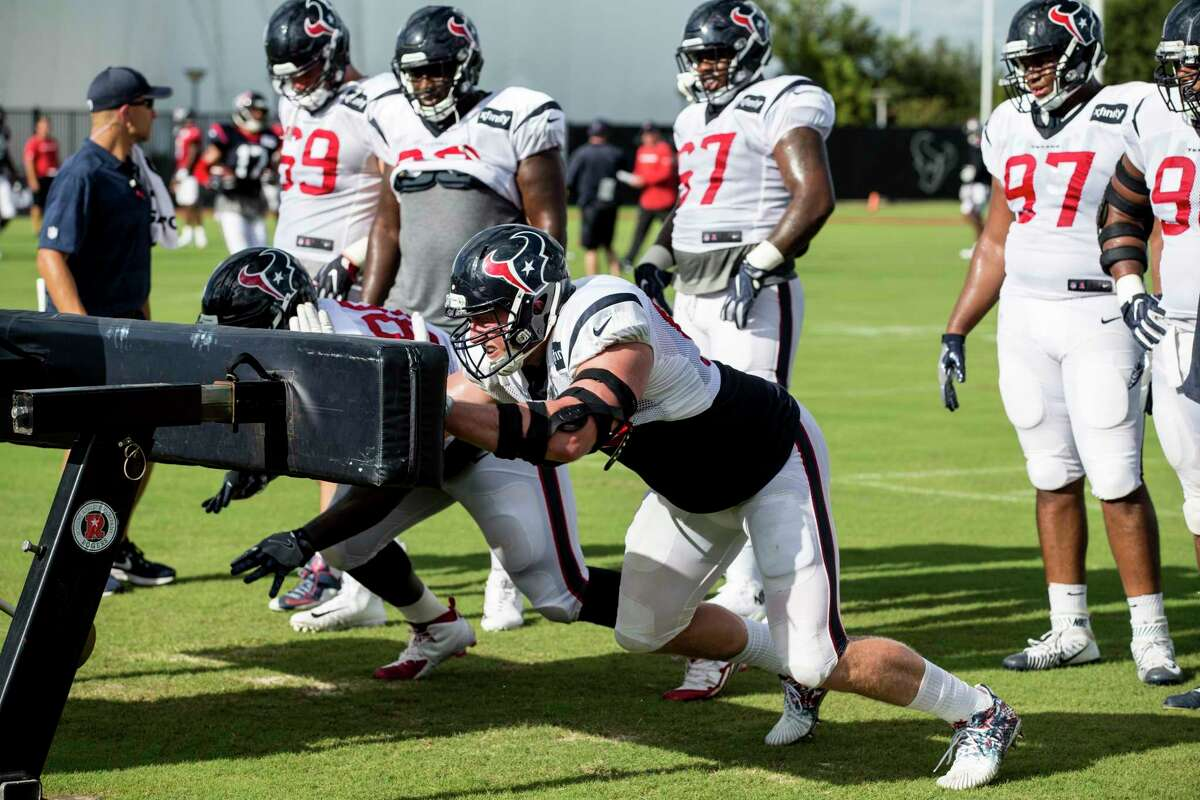 Houston Texans defensive end J.J. Watt (99) hits a blocking sled during training camp at The Methodist Training Center on Tuesday, Aug. 22, 2017, in Houston.