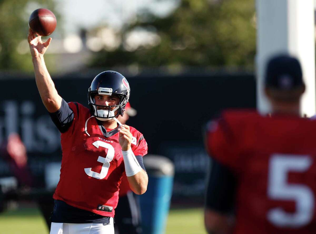 Houston Texans quarterback Tom Savage (3) throws a football to Brandon Weeden as he warm up before practice during training camp at The Methodist Training Center on Tuesday, Aug. 22, 2017, in Houston.