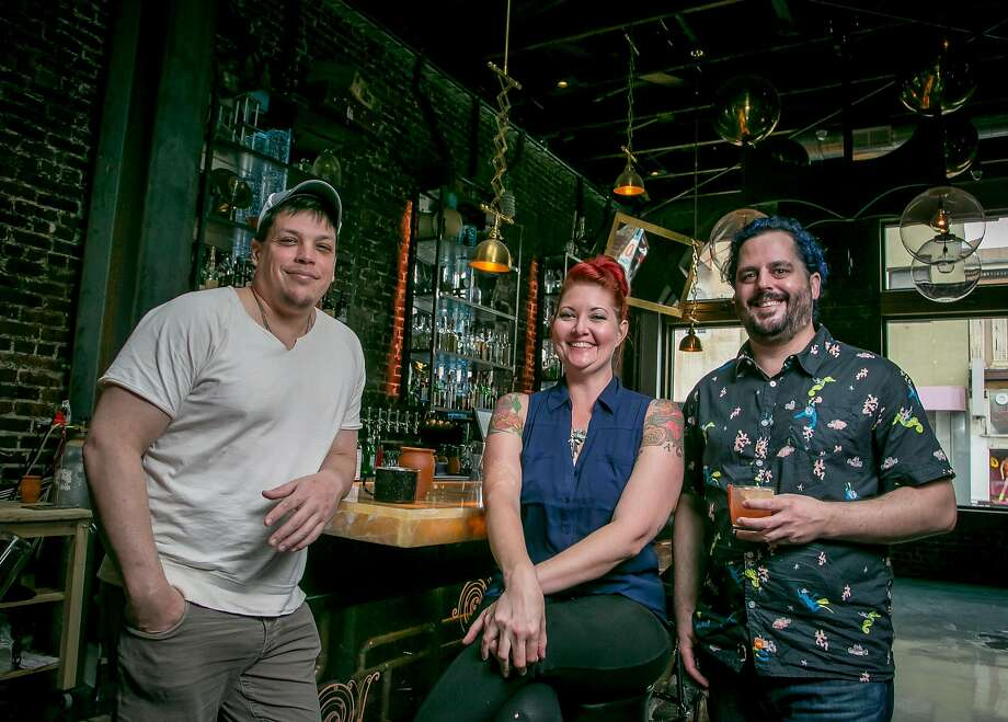 Rusted Mule owners Kristian Cosentino (left), Christina Mae Henderson and Chris Mansury at their bar. Photo: John Storey, Special To The Chronicle