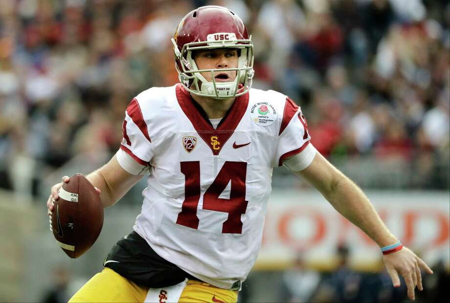 FILE - In this Jan. 2, 2017, file photo, Southern California quarterback Sam Darnold looks to pass against Penn State during the Rose Bowl NCAA college football game in Pasadena, Calif. Southern California and Washington are the strong favorites to win their respective Pac-12 divisions. (AP Photo/Jae C. Hong, File) Photo: Jae C. Hong, STF / Copyright 2017 The Associated Press. All rights reserved.