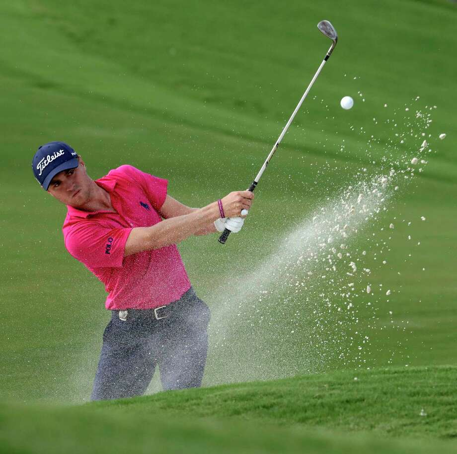 File-This Aug. 13, 2017, file photo shows Justin Thomas hitting from the bunker on the 18th hole during the final round of the PGA Championship golf tournament at the Quail Hollow Club in Charlotte, N.C. The FedEx Cup isn't the only trophy at stake over the next five weeks. One trophy is known for its $10 million prize, with $9 million in cash. The other is about respect and honor from the other players. (AP Photo/John Bazemore, File) Photo: John Bazemore, STF / Copyright 2017 The Associated Press. All rights reserved.