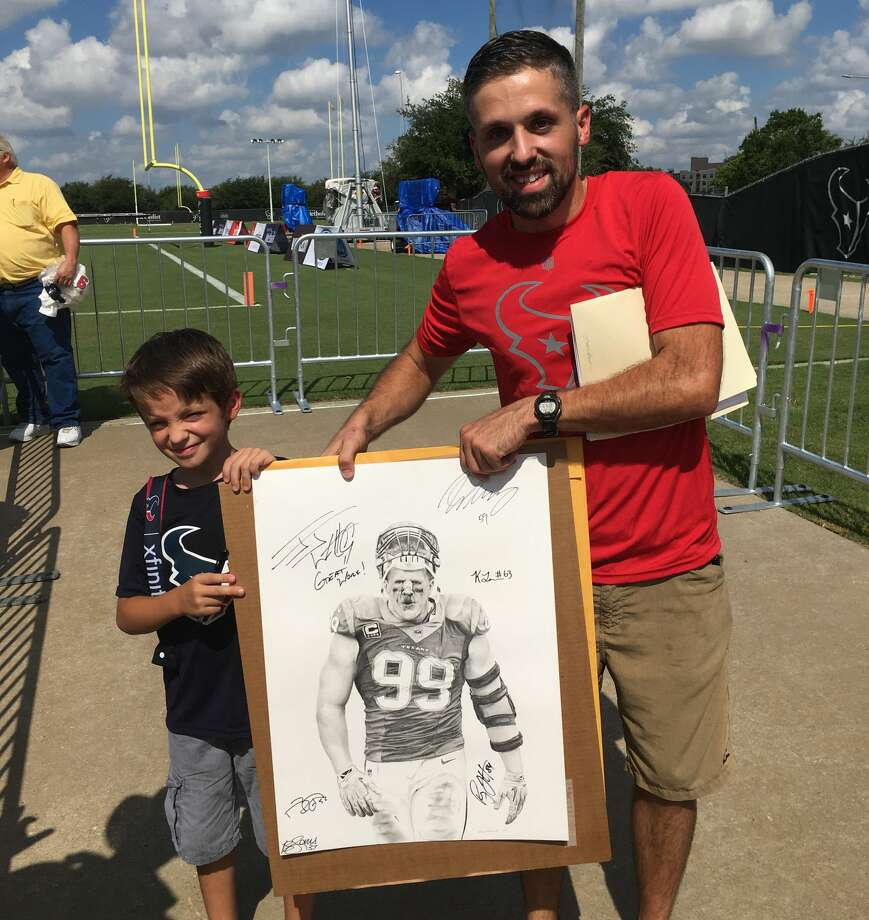 PHOTOS: A look at J.J. Watt at Houston Texans training campTerry Harman and his son show off his J.J. Watt pencil drawing that he got Watt to autograph after Monday's Houston Texans practice.Browse through the photos above to see J.J. Watt at Houston Texans training camp. Photo: Terry Harman